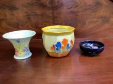 A small moorcroft dish, together with a crocus hand painted bowl from the Bizarre range by Clarice