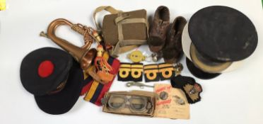 A mixed lot including a French Naval beret, two various peaked caps, a bugle, two pairs of