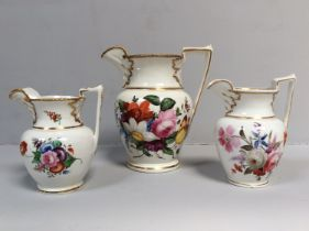 Three various early 19th century English porcelain jugs, probably Staffordshire, with ovoid body and