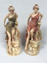 Two matching Royal Dux porcelain figural spill vases modelled as classical maidens, each sat atop
