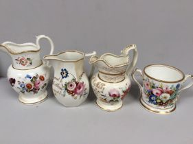 An early 19th century Staffordshire porcelain two-handled loving cup painted with roses and gilt