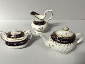 A Chamberlains Worcester teapot of oval form with spiral fluted body, decorated with gilding and