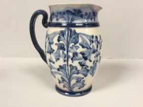 A Macintyre Florian Ware pottery jug with tube-lined and blue glazed floral decoration, Reg No.