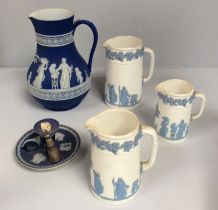 A set of three graduated Wedgwood Embossed Queen's Ware jugs, together with a Jasper dip large