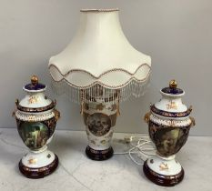 A pair of 20th century porcelain vases and covers, of baluster form decorated with scenes of putti
