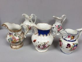 Five various 19th century Staffordshire porcelain jugs with hand-painted polychrome floral