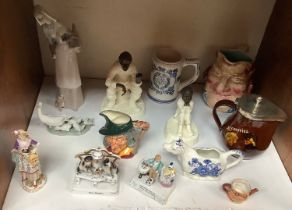 SECTION 15. Two various Minton pottery and bronzed figures 'Travellers Tales' and 'Spellbound',