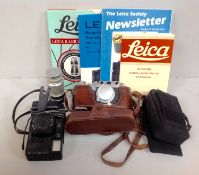 A Leica D.R.P. Ernst Leitz Wetzlar camera, No. 283336, in original brown leather case, together with
