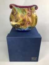 An Isle of Wight studio glass oval vase with twin scrolled ends, decorated with a swirl design in