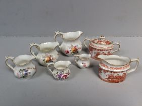 Five graduated Royal Crown Derby porcelain 'posies' cream jugs, together with a Royal Crown Derby '