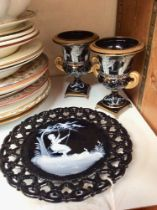 SECTION 26. A pair of black pottery campagna vases and pierced plate with Mary Gregory style