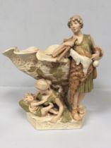 A Royal Dux porcelain centrepiece vase modelled as a classical male figure wearing a goatskin,