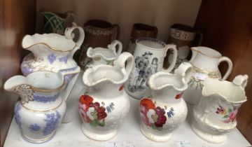 SECTION 7. Twelve various 19th century ceramic jugs including four hand-painted floral jugs, a