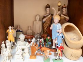 SECTION 9. A collection of modern hand-carved 'naive style' wooden figures, some painted, together