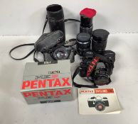Two Pentax ME Super cameras, one with original box and manual and one fitted with a Pentax 50mm F1.7