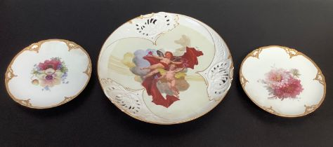 A large Meissen porcelain circular wall charger with pierced rim and painted with cherubs, 36cm
