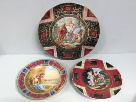 An early 19th century Vienna porcelain cabinet plate, hand-painted to the centre with two young