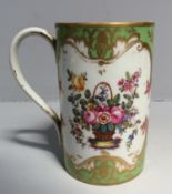 A 19th century Rockingham porcelain tankard, c.1830-40, hand-painted with floral reserves and gilded
