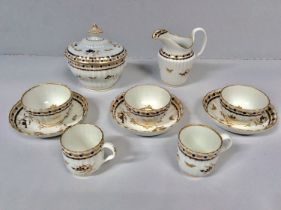 An 18th century Worcester porcelain part tea service decorated with blue and gilt sprigs, to