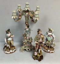 A Dresden style porcelain four-light candelabra, modelled in a rustic style with female figure and