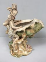 A Royal Dux porcelain figural centrepiece modelled as a conch shell vase mounted with two semi-naked
