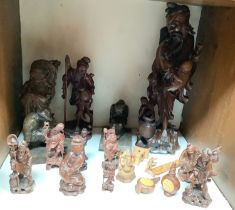 SECTION 16. Various Oriental carved wood figures including a pair of bookends and deities etc.