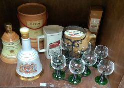 A set of eight French Luminarc glasses with green graduated stems with circular metal stand with