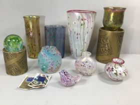 Five various Isle of Wight studio glass vases, together with an Isle of Wight glass bird