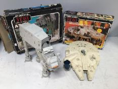 A Millennium Falcon Vehicle from Star Wars Return of the Jedi by Palitoy, together with an At-At