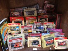 A collection of approximately 50 assorted boxed die-cast model vehicles, predominantly Lledo 'Days