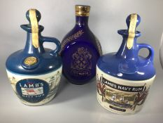 Two x 750ml Lamb's Navy Rum housed in ceramic decanters, one with HMS Warrior on the front, seals