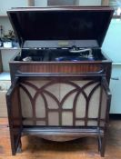 A mahogany cased Full-O-Tone cabinet gramophone with wind up handle, pair of cupboard doors