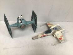 A Star Wars Imperial Tie Fighter, together with a Star Wars X-Wing Fighter and an action figure