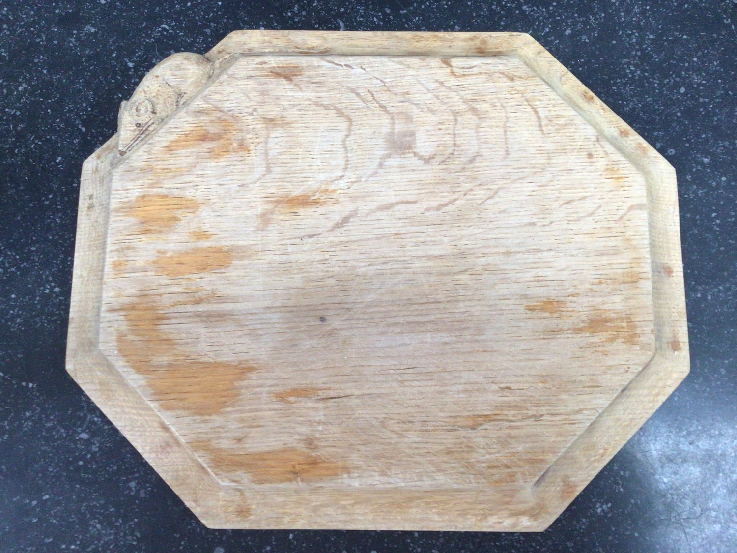 An octagonal cheeseboard by Robert 'Mouseman' Thompson with trademark carved mouse, 32cm diam