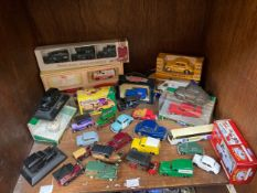 A collection of assorted boxed and loose die-cast model cars, predominantly Corgi examples, some