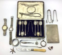 A small collection of assorted silver items comprising a pair of sugar tongs by William Woodman,