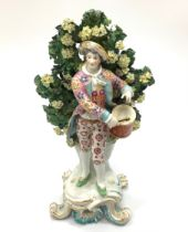 A Chelsea Gold Anchor figure of a drummer boy, modelled on a rococo base against floral bocage, '