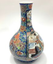 An early 20th century Japanese porcelain vase of onion form, decorated in polychrome enamels with