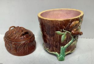 A 19th century Majolica pottery jardiniere modelled as a tree-stump with vines, fruiting flowers and