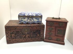 A 19th century Dutch Delft blue and white tin glazed casket / jewellery box decorated with a scene