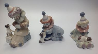 Three Lladro porcelain Clown / Pierrot figures including 'Pierrot with Puppy' No. 5277, 'Pierrot