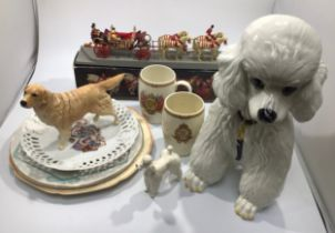 A large Italian pottery poodle together with a Beswick poodle, a Beswick Golden Retriever, a
