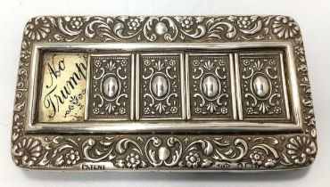 An Edwardian silver trump bridge marker with shell and foliate embossed decoration, four sliding