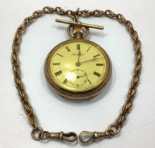 A gold-plated open-faced pocket watch by Prescot, the white enamel dial with Roman numerals denoting