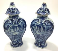 A pair of 18th Century Delft pottery vases of inverted baluster form with chinoiserie decoration,