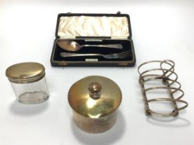 A silver four section toast rack, Birmingham, maker's mark of Elkington & Co, together with a