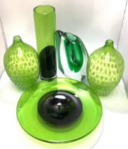 A heavy green glass vase signed 'Patr 98' to base, together with a pair of green and white opaque