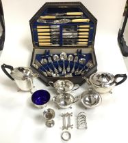 A silver toast rack by W Batty & Sons, hallmarked Sheffield, 1937, together with a filled silver