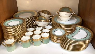 An Aynsley part dinner and coffee service, decorated in a green, white and gilded design and