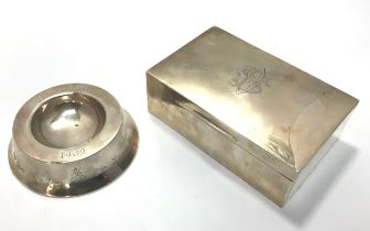 A rectangular silver cigarette box with cedar lining, the cover with central engraved stylised
